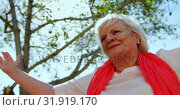 Купить «Low angle view of active Caucasian senior woman performing yoga in the garden of nursing home 4k», видеоролик № 31919170, снято 22 ноября 2018 г. (c) Wavebreak Media / Фотобанк Лори