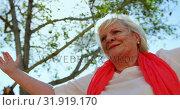 Low angle view of active Caucasian senior woman performing yoga in the garden of nursing home 4k. Стоковое видео, агентство Wavebreak Media / Фотобанк Лори