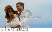 Купить «Side view of Caucasian couple embracing each other on the beach 4k», видеоролик № 31919242, снято 12 ноября 2018 г. (c) Wavebreak Media / Фотобанк Лори