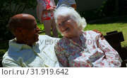 Купить «Front view of active mixed-race senior couple smiling and looking at each other in the garden of nur», видеоролик № 31919642, снято 22 ноября 2018 г. (c) Wavebreak Media / Фотобанк Лори