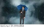 Купить «Businessman with his umbrella under the storm», видеоролик № 31919854, снято 5 марта 2019 г. (c) Wavebreak Media / Фотобанк Лори