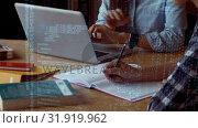 Купить «Students at a work desk», видеоролик № 31919962, снято 5 марта 2019 г. (c) Wavebreak Media / Фотобанк Лори