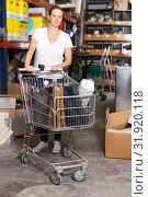 Купить «Female with purchases in build store», фото № 31920118, снято 20 сентября 2018 г. (c) Яков Филимонов / Фотобанк Лори