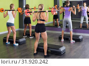 athletic girls during workout in gym with barbell. Стоковое фото, фотограф Яков Филимонов / Фотобанк Лори