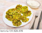 Купить «Fried zucchini fritters», фото № 31920378, снято 14 декабря 2019 г. (c) Яков Филимонов / Фотобанк Лори