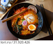 Купить «Traditional japanese noodle soup with shiitake mushroom, egg and greens served in ceramic bowl with wooden chopsticks», фото № 31920426, снято 22 января 2020 г. (c) Яков Филимонов / Фотобанк Лори