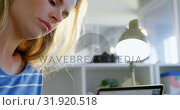 Купить «Side view of Caucasian female fashion designer using graphic tablet at desk in office 4k», видеоролик № 31920518, снято 18 ноября 2018 г. (c) Wavebreak Media / Фотобанк Лори