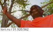 Купить «Low angle view of active African American senior man performing yoga in the garden of nursing home 4», видеоролик № 31920562, снято 22 ноября 2018 г. (c) Wavebreak Media / Фотобанк Лори