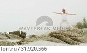 Купить «Front view of Caucasian woman performing yoga on the beach 4k», видеоролик № 31920566, снято 12 ноября 2018 г. (c) Wavebreak Media / Фотобанк Лори