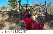 Купить «Male trainer training kids in the boot camp on a sunny day 4k», видеоролик № 31920874, снято 29 августа 2017 г. (c) Wavebreak Media / Фотобанк Лори