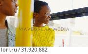 Купить «Twin sisters looking through window in the bus 4k », видеоролик № 31920882, снято 6 мая 2018 г. (c) Wavebreak Media / Фотобанк Лори