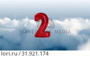 Купить «Number 2 inflatable against cloudy skies», видеоролик № 31921174, снято 5 марта 2019 г. (c) Wavebreak Media / Фотобанк Лори