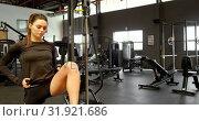 Купить «Woman exercising in fitness studio 4k», видеоролик № 31921686, снято 26 июня 2018 г. (c) Wavebreak Media / Фотобанк Лори