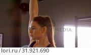 Купить «Woman exercising in a fitness studio 4k», видеоролик № 31921690, снято 26 июня 2018 г. (c) Wavebreak Media / Фотобанк Лори