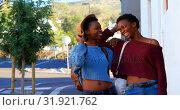 Купить «Twin sisters standing together in the city 4k», видеоролик № 31921762, снято 6 мая 2018 г. (c) Wavebreak Media / Фотобанк Лори