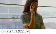 Купить «Businesswoman talking on mobile phone in a modern office 4k», видеоролик № 31922070, снято 6 декабря 2018 г. (c) Wavebreak Media / Фотобанк Лори