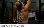 Купить «Female athlete exercising in fitness studio », видеоролик № 31922118, снято 25 мая 2018 г. (c) Wavebreak Media / Фотобанк Лори