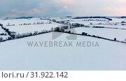 Купить «Beautiful snowy landscape during winter 4k», видеоролик № 31922142, снято 28 марта 2018 г. (c) Wavebreak Media / Фотобанк Лори