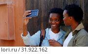 Купить «Twin sisters taking selfie with mobile phone in the city 4k», видеоролик № 31922162, снято 6 мая 2018 г. (c) Wavebreak Media / Фотобанк Лори