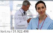 Купить «Caucasian female doctor smiling. Behind her there are two caucasian male doctors interacting togethe», видеоролик № 31922498, снято 5 марта 2019 г. (c) Wavebreak Media / Фотобанк Лори