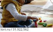 Купить «Boy playing with building blocks in a comfortable home 4k», видеоролик № 31922562, снято 6 июня 2018 г. (c) Wavebreak Media / Фотобанк Лори