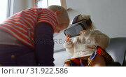 Купить «Siblings using virtual reality headset in living room at home 4k», видеоролик № 31922586, снято 28 мая 2018 г. (c) Wavebreak Media / Фотобанк Лори