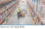 Купить «Man dragging a fork lift inside a warehouse», видеоролик № 31922810, снято 27 марта 2019 г. (c) Wavebreak Media / Фотобанк Лори