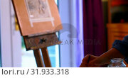 Купить «Female painter painting on a canvas at home 4k», видеоролик № 31933318, снято 9 марта 2018 г. (c) Wavebreak Media / Фотобанк Лори