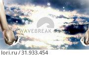 Купить «Glowing hands in the sky», видеоролик № 31933454, снято 26 марта 2019 г. (c) Wavebreak Media / Фотобанк Лори
