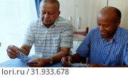 Group of senior friends playing cards at nursing home 4k. Стоковое видео, агентство Wavebreak Media / Фотобанк Лори
