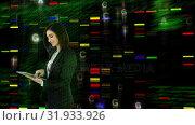 Купить «Businesswoman using a digital tablet», видеоролик № 31933926, снято 27 марта 2019 г. (c) Wavebreak Media / Фотобанк Лори