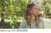 Купить «Side view of a woman in a park», видеоролик № 31934050, снято 5 апреля 2019 г. (c) Wavebreak Media / Фотобанк Лори