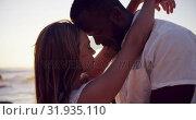 Купить «Couple embracing each other on the beach 4k», видеоролик № 31935110, снято 24 января 2019 г. (c) Wavebreak Media / Фотобанк Лори