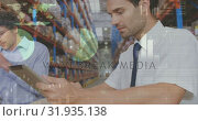 Купить «Warehouse worker smiling 4k», видеоролик № 31935138, снято 5 апреля 2019 г. (c) Wavebreak Media / Фотобанк Лори