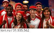 Купить «Sports fans cheering loudly 4k», видеоролик № 31935562, снято 5 апреля 2019 г. (c) Wavebreak Media / Фотобанк Лори