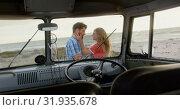 Купить «Couple embracing each other near camper van 4k», видеоролик № 31935678, снято 9 января 2019 г. (c) Wavebreak Media / Фотобанк Лори