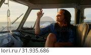 Купить «Woman relaxing in camper van at beach 4k», видеоролик № 31935686, снято 9 января 2019 г. (c) Wavebreak Media / Фотобанк Лори