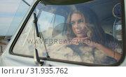 Купить «Young woman relaxing in camper van 4k», видеоролик № 31935762, снято 9 января 2019 г. (c) Wavebreak Media / Фотобанк Лори