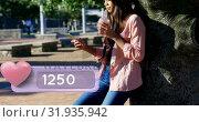 Купить «Teenager hanging out in the park texting 4k», видеоролик № 31935942, снято 5 апреля 2019 г. (c) Wavebreak Media / Фотобанк Лори