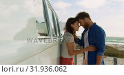 Купить «Couple embracing each other near camper van 4k», видеоролик № 31936062, снято 9 января 2019 г. (c) Wavebreak Media / Фотобанк Лори