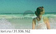 Купить «Woman enjoying at the beach 4k», видеоролик № 31936162, снято 17 апреля 2019 г. (c) Wavebreak Media / Фотобанк Лори