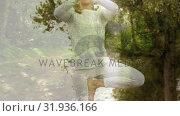 Купить «Woman meditating among the trees», видеоролик № 31936166, снято 18 апреля 2019 г. (c) Wavebreak Media / Фотобанк Лори