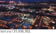 Купить «Industrial background with modern large chemical factory at night, Salou, Spain», видеоролик № 31936302, снято 22 мая 2019 г. (c) Яков Филимонов / Фотобанк Лори