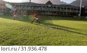 Купить «Male rugby players playing rugby in the stadium 4k», видеоролик № 31936478, снято 16 января 2019 г. (c) Wavebreak Media / Фотобанк Лори