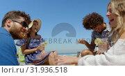 Купить «Group of friends having fun at beach 4k», видеоролик № 31936518, снято 9 января 2019 г. (c) Wavebreak Media / Фотобанк Лори