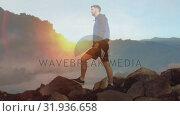 Купить «Hiker standing mountain rocks», видеоролик № 31936658, снято 18 апреля 2019 г. (c) Wavebreak Media / Фотобанк Лори