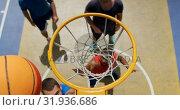 Купить «Basketball players playing basketball 4k», видеоролик № 31936686, снято 30 января 2019 г. (c) Wavebreak Media / Фотобанк Лори