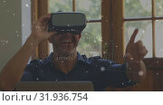 Купить «Man wearing a virtual reality headset having fun», видеоролик № 31936754, снято 25 апреля 2019 г. (c) Wavebreak Media / Фотобанк Лори