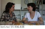 Купить «Happy young woman talking with mature woman at table in home together», видеоролик № 31936838, снято 27 мая 2019 г. (c) Яков Филимонов / Фотобанк Лори
