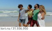 Купить «Group friends with arms around walking 4k», видеоролик № 31936950, снято 9 января 2019 г. (c) Wavebreak Media / Фотобанк Лори
